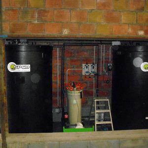 Storage tank for waste water laden with paint, glue or resin treatment through coagulation automated system to decontaminate and reuse water